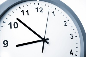 Hands of clock pointing to nine o'clock